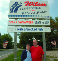 Ralph and Shirley Wilcox outside of their restaurant